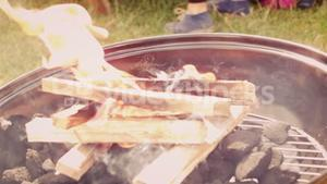 In slow motion flaming barbecue in the park