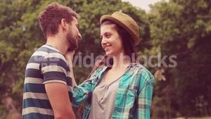 In slow motion young couple smiling at each other