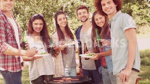 In slow motion happy friends in the park having barbecue