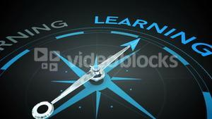 Compass pointing to learning