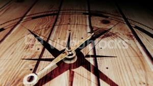 Compass pointing on wooden surface