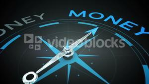 Compass pointing to money