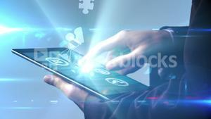 Businessman using tablet to view holographic apps
