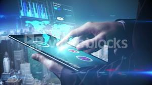 Businessman using tablet to view holographic interface