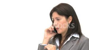 Angry businesswoman talking on the phone