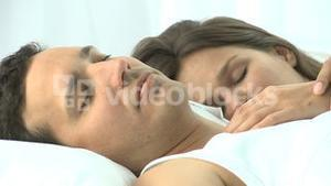 Beautiful couple sleeping together in the bed