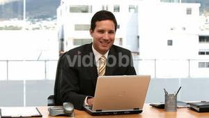 Happy businessman working on the laptop