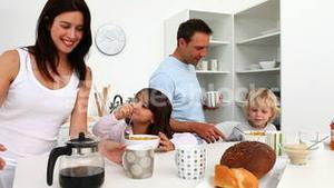 Family taking breakfast together