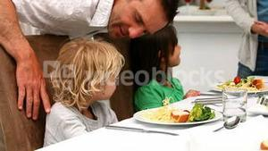 Parents trying to convince kids to eat vegetables