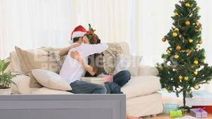 Couple hugging after opening Christmas gifts