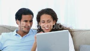 Closeup of a couple watching a video on the computer