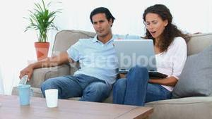 Couple watching a video on the computer