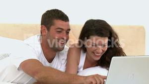 Couple looking a video on the laptop
