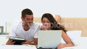 Couple looking at a video on the computer