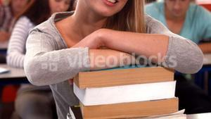 Student smiling at camera in class