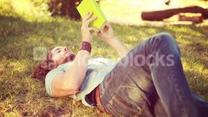 In high quality 4k format young man reading book in the park