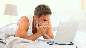A very angry man on his laptop