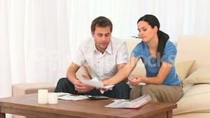 Worried couple calculating their domestic bills