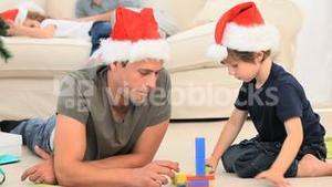 A lovely boy playing with his father