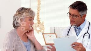 Doctor speaking with his patient in office