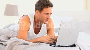 Annoyed man working on his laptop