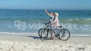 Elderly couple walking with bikes