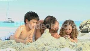 Father and his childs building a sand castle