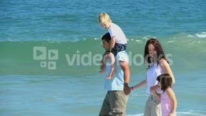 Cute family walking along the sea