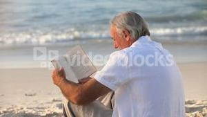 Aged man reading a book