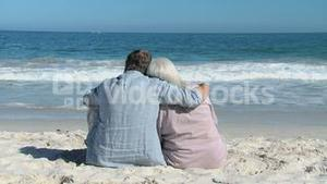 Elderly man and woman looking at the ocean