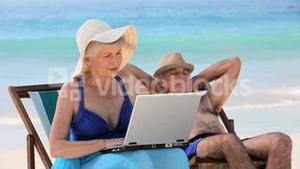 Elderly woman working on the laptop
