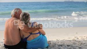 Elderly woman and man looking at the horizon