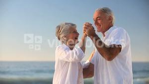 Elderly woman dancing with her husband
