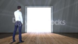 Door opening to light watched by businessman