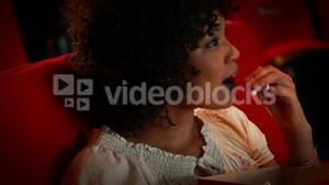 Happy young woman watching movie