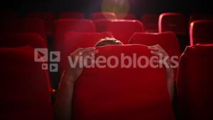 Young man watching a scary film