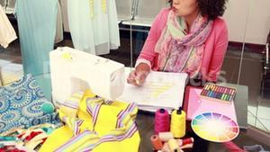 Attractive female fashion designer drawing at work