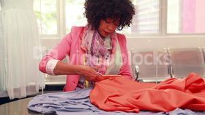 Female fashion designer at work
