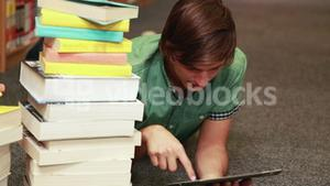 Focused student using tablet pc