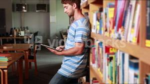 Serious student using tablet pc