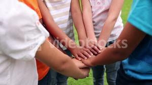 Pupils holding hands together and cheering outside