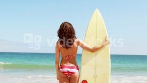 Gorgeous brunette going to surf