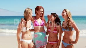 Friends laughing together at the beach