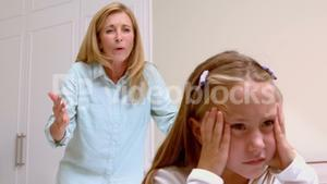 Upset mother scolding her daughter