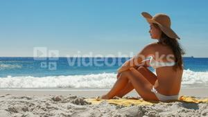 Beautiful woman relaxing at beach