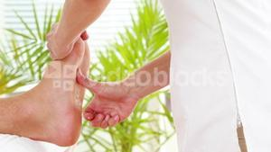 Physiotherapist giving sports massage to patient