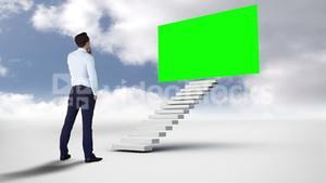 Businessman looking at a green screen in the cloudy sky