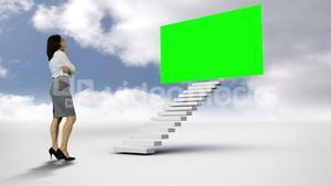 Businesswoman looking at green screen in the cloudy sky