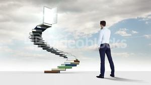 Businessman looking at steps made of books