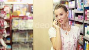 Young happy woman having a phone call